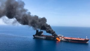 The crude oil tanker Front Altair on fire in the Gulf of Oman on 13 June