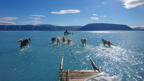 Danish scientists had to wade through the melting ice water to retrieve their equipment (Courtesy: DMI/Steffen M Olsen)