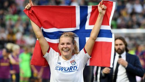 Ada Hegerberg celebrating Lyon's Champions League success in May
