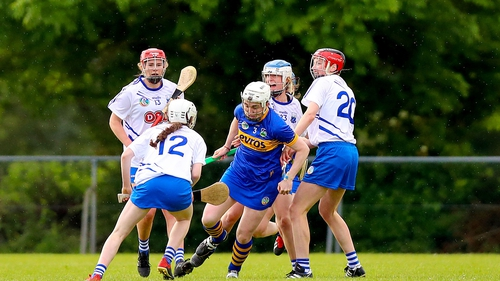 Tipperary's Gemma Grace looks to evade a huddle of Waterford players