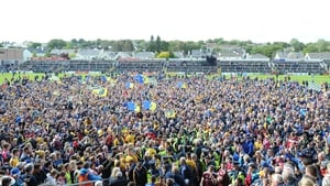Roscommon fans on the pitch after their Connacht success