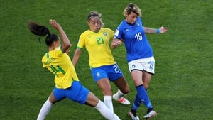 Brazil's Kathellen, Monica and Italy's Valentina Giacinti battle for the ball