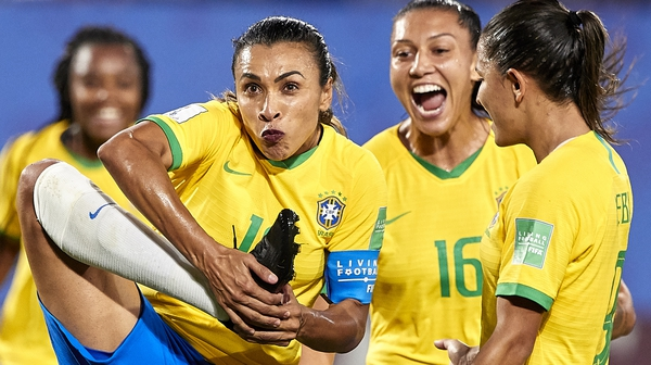 Marta kissed her boot, which bears a gender equality symbol, after scoring against Italy