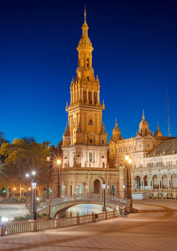 The historic Plaza de España in Seville is spotlit in the evening (Turismo de Sevilla/PA)