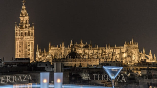 Seville Cathedral at night from the terrace of the Hotel Inglaterra (Turismo de Sevilla/PA)