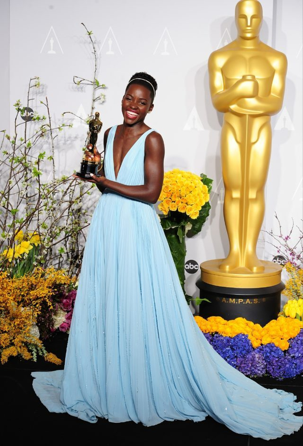 Lupita Nyong'o in Prada, with her award for Best Supporting Actress (Ian West/PA)