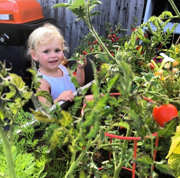 Lee encourages his daughter Olive to grow her own veg (Lee Connelly/PA)
