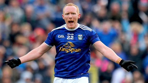 Cavan's Cian Mackey celebrates scoring a point in extra time to force a replay