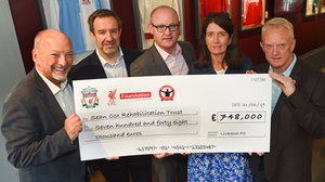 The cheque was presented to Sean Cox's wife Martina