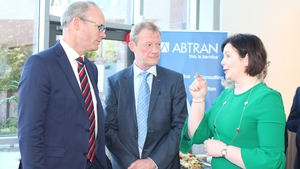 Tanaiste Simon Coveney, Mike Maloney, Executive Chairman of Abtran and Marguerite Sayers, Electric Ireland's executive director at Abtran's headquarters in Cork