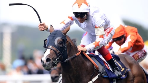Advertise ridden by jockey Frankie Dettori coming home to win the Commonwealth Cup