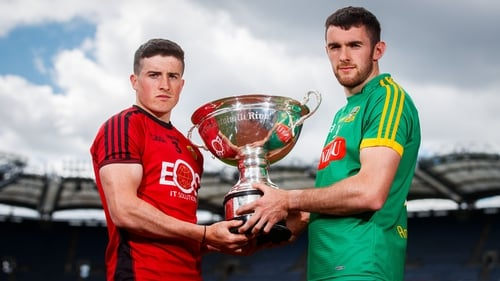 Down's Caolan Taggart (L) and Sean Geraghty of Meath with the Christy Ring Cup