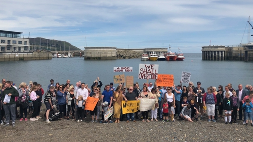 More than 200 people took part in a demonstration in support of the local fishermen earlier today