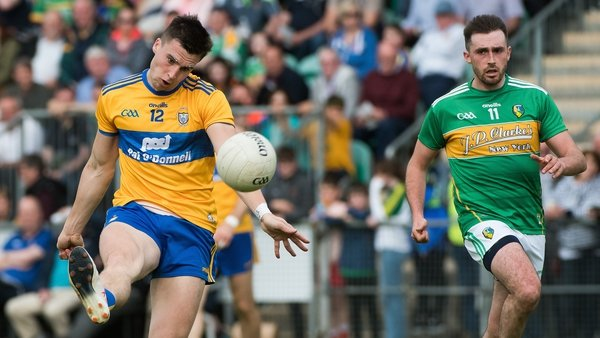 Jamie Malone kicks a point for a dominant Clare