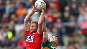 Ruairi Deane and Gavin White contest a high ball at Pairc Ui Chaoimh