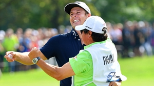 Andrea Pavan celebrates with his caddie on the 18th green at Golfclub Munchen Eichenried
