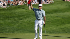 Chez Reavi salutes the crowd after winning the Travelers Championship