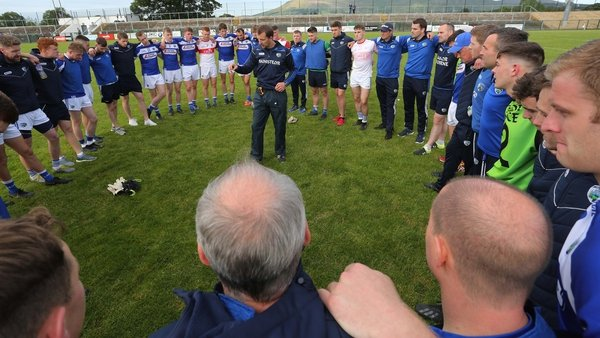 Laois manager John Sugrue speaks to his players after their win against Derry. They are in this morning's round-three draw.
