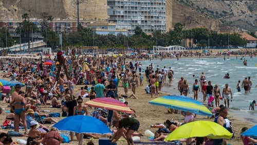 Packed beach in Alicante, Spain, as temperatures set to soar