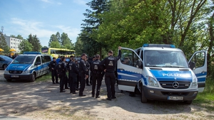 Police at the entrance to the site of the crash