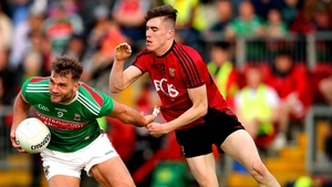 Down's Owen McCabe up against Mayo's Aidan O'Shea during last weekend's round 2 qualifier in Newry