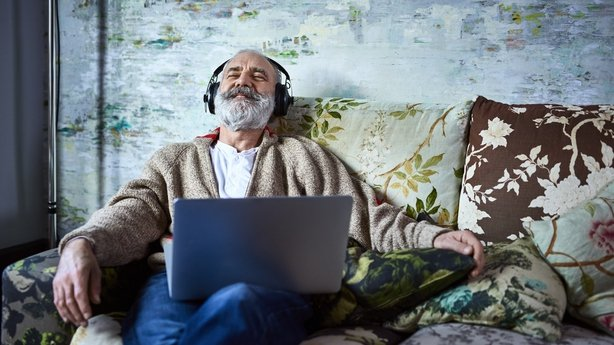 man listening to music on his laptop