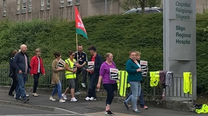 Striking staff at Sligo University Hospital take to the picket line