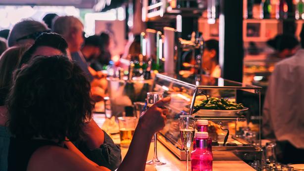Customers eating foods at Mercado San Miguel Market in Madrid,Spain