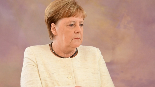 Angela Merkel was seen visibly shaking for about two minutes