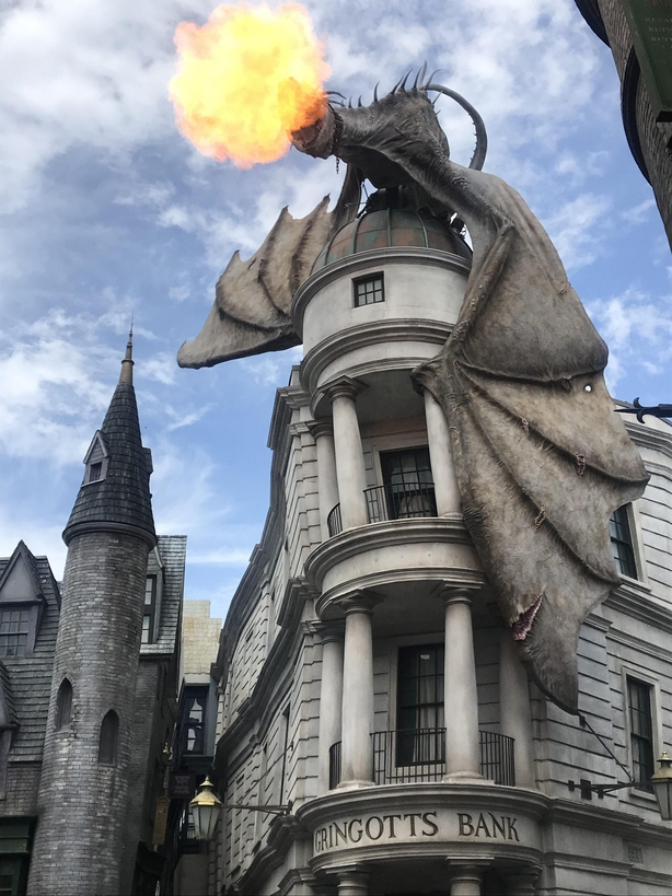 Muggles wandering the magical alleyway may be startled by the fire-breathing dragon atop of Gringott's bank (Jemma Crew/PA)