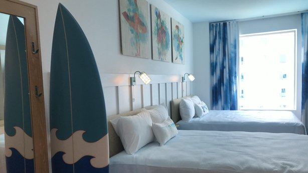 Surfboards and seascapes channel a relaxed beach vibe in the new budget resort (Jemma Crew/PA)