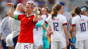 Megan Rapinoe celebrates after her side beat Spain in the round of 16