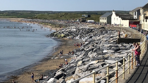 Crowds flocked to enjoy the sun, sea and sand in Lahinch, Co Clare
