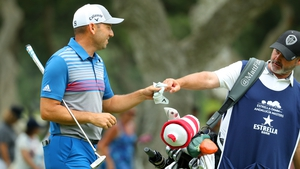 Sergio Garcia fist bumps Matt Fitzpatrick's caddie Billy Foster after his second shot on the 9th hole