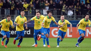 Brazil celebrate winning the penalty shoot-out following