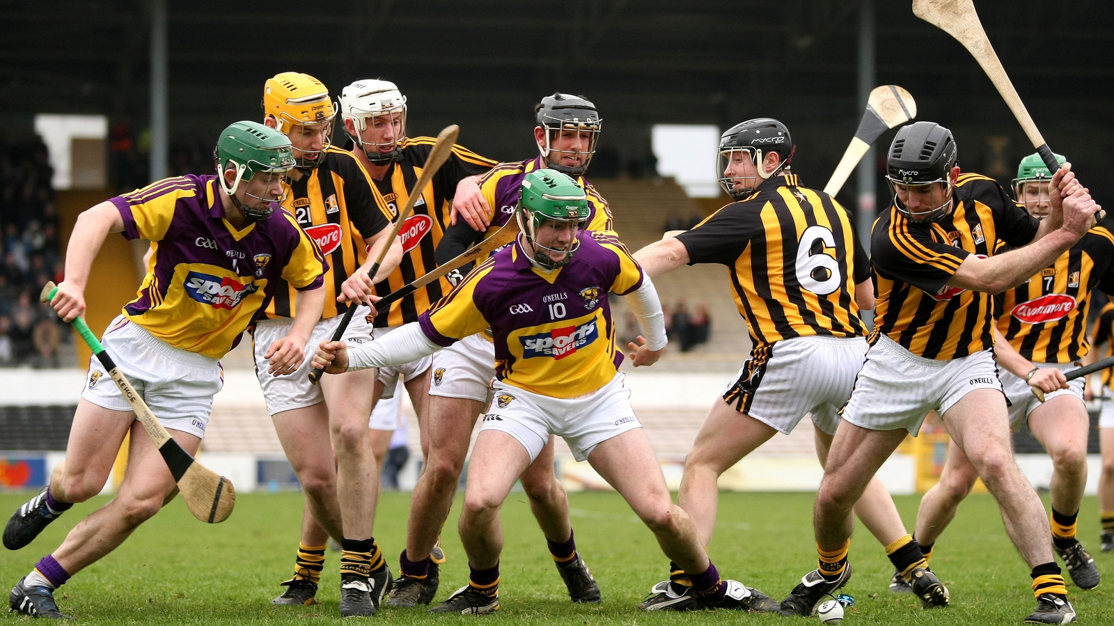 Image - Noel Hickey (R) prepares to make a clearance against Wexford in 2011