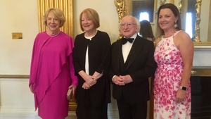 President Michael D Higgins and his wife Sabina, Kathleen Watkins and Suzy O'Byrne at the ceremony in Dublin Castle on Friday evening