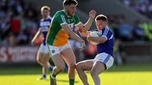 Laois' Ross Munnelly and Cian Donohoe of Offaly
