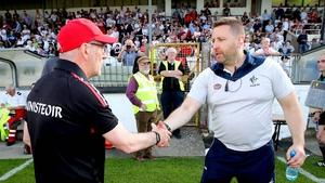 Cian O'Neill shakes hands with Mickey Harte after the game
