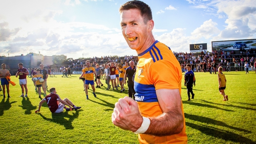 Gary Brennan celebrates at the full-time whistle