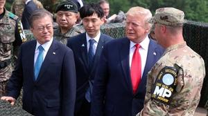 Donald Trump tours the Demilitarised Zone alongside Moon Jae-in