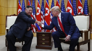 The pair shake hands during a sit down meeting