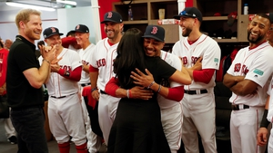 Meghan embraces Red Sox player Mookie Betts. Image: PA