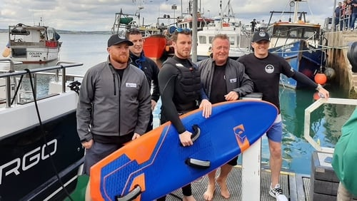 Kite surfer Eoghan Quinn together with his support team from the Camila E (Pic: Peter O'Shea)