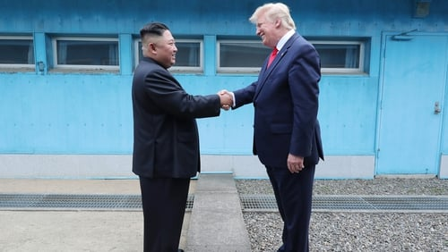 The two leaders shook hands over the concrete slabs dividing North and South