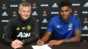 Marcus Rashford puts pen to paper as he commits to four more years at United
