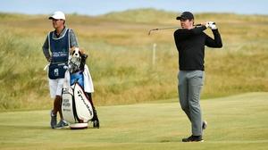 Rory McIlroy (R) and caddy Harry Diamond at last year's Irish Open.