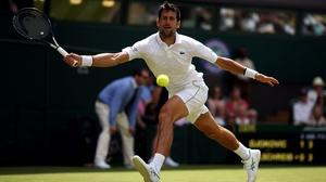 Novak Djokovic in action on day one of Wimbledon
