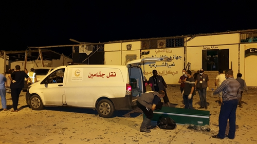 Emergency workers recover bodies after an airstrike at the Tajoura Detention Center, east of Tripoli