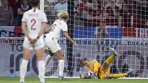 Alyssa Naeher saves from the penalty spot